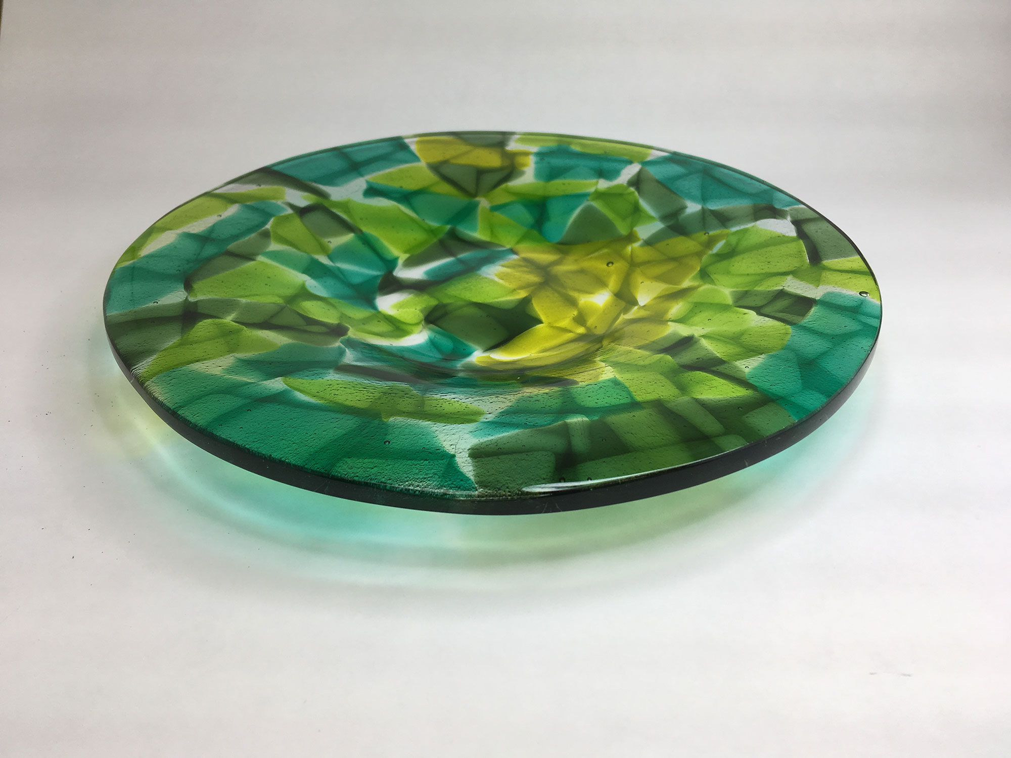 Pieces of Green Round Plate
