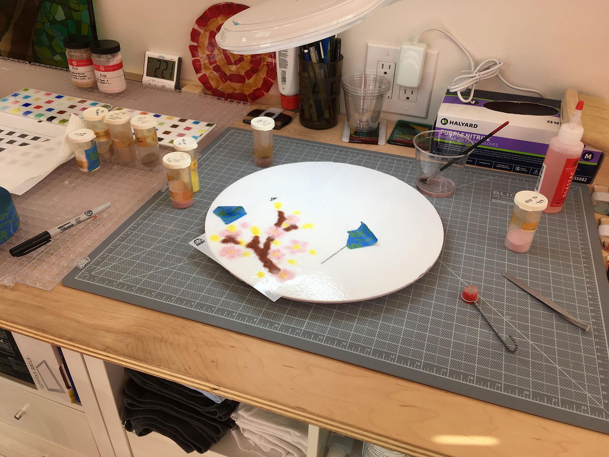 Applying the Enamel Powder Through the Stencil
